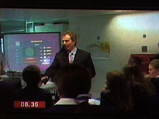 Tony Blair with Planet 10 in the background